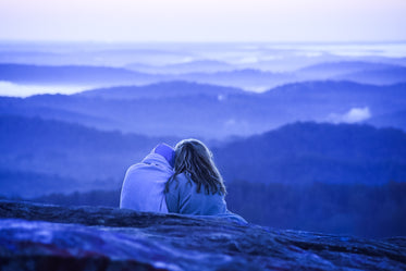 couple cuddles watching over nature