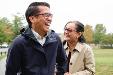 couple laugh in a local park