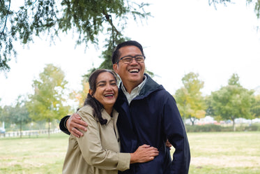 couple laugh while in the park