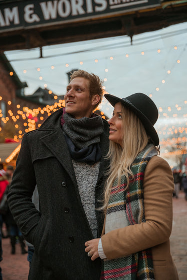 couple looking at holiday lights