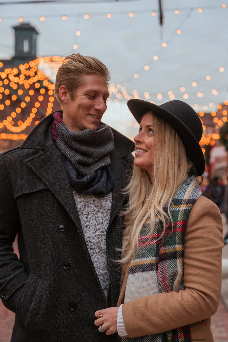 Couple Portrait In Holiday Lights