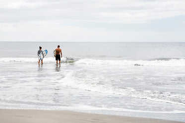 couple ready to surf