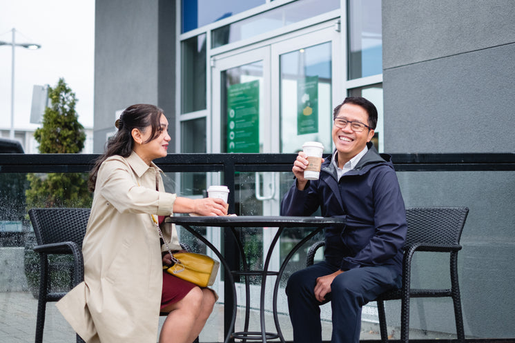 Couple Sits On Patio Laughing