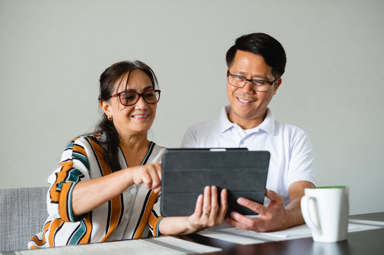 Couple Use A Tablet Together