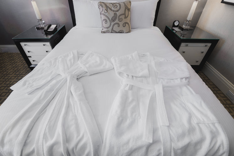 Couples Hotel Bath Robes On Holiday