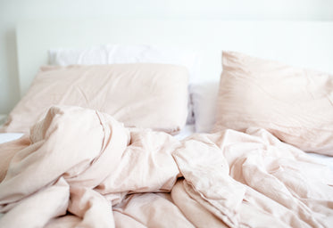 cozy light pink bed scene