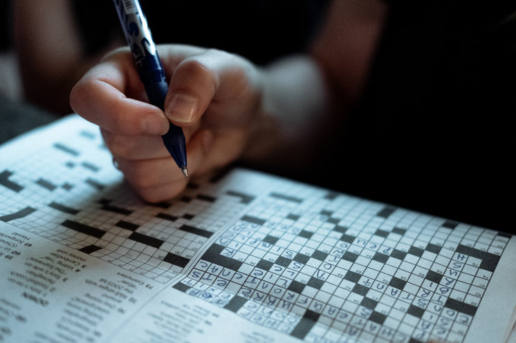 Crossword Puzzle Pen In Hand