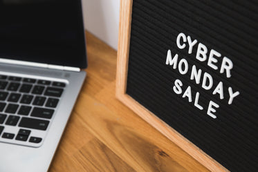 cyber monday sale sign by computer