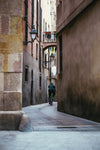 cycling down narrow alley