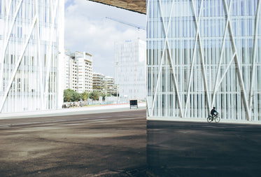 Free Cyclist By Modern Building Image: Stunning Photography