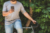 cyclist holding phone