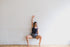 dancer poses with arm above head