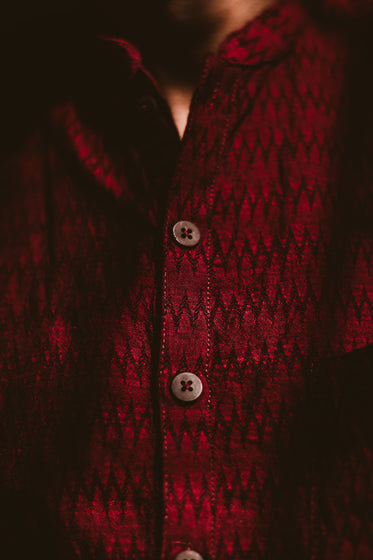 dark red shirt with wooden buttons