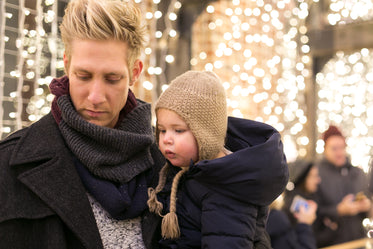 daughter and father at christmas market