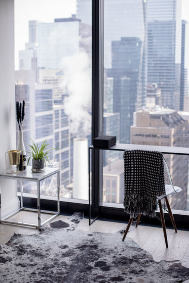 desk and chair look out to the city below