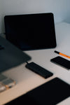 desk with some black gadgets in focus