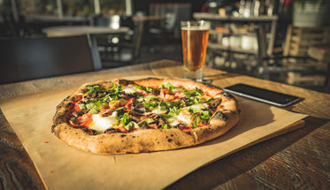 dinner for one of wood fired pizza paired with cold beer
