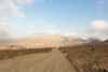 dirt road leading to spanish mountains