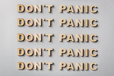don't panic statement in wooden letters