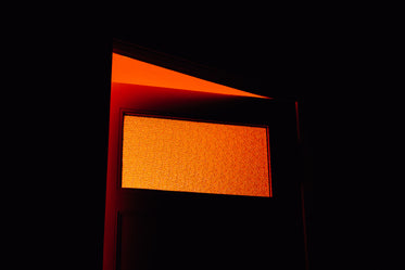 door with frosted window lets in orange sunlight