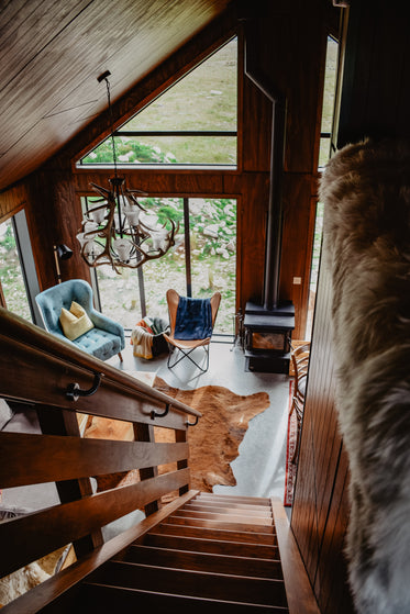 down the stairs of a wooden cabin