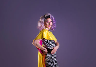 drag performer with purple wig twists