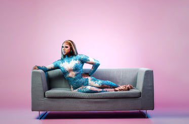 drag queen poses on sofa