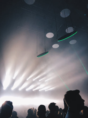 dramatic white lights at a concert