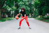 dribbling a basketball in the street