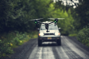 drone flying over road