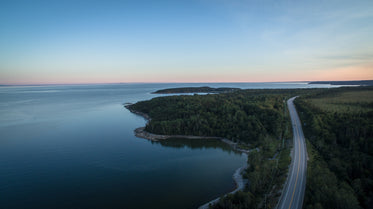 drone photography of lakeside highway