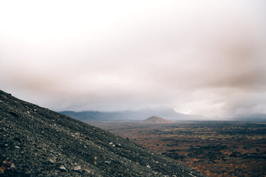 dry rocky landscape with low clouds