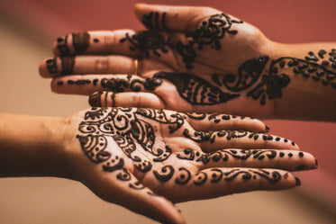 drying henna on persons palms