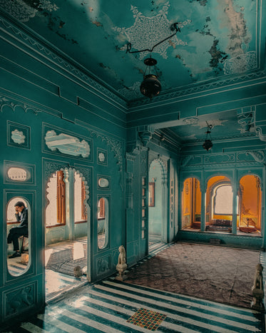 elaborate building interior with light teal walls