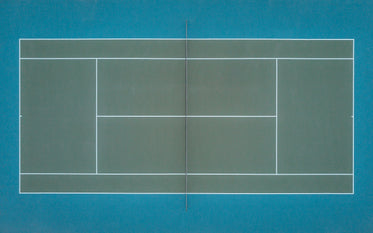 emerald green tennis court as seen from above by a drone