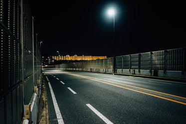 empty and enclosed highway at night
