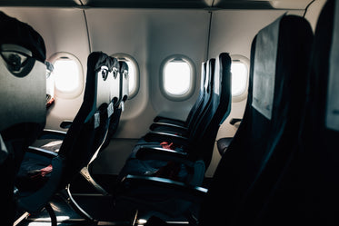 empty black seats on a commercial airplane