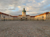 empty cobblestone courtyard to a palace