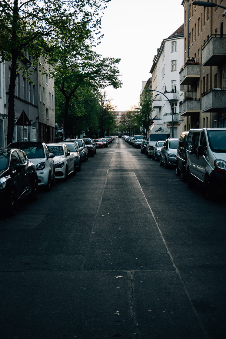 Empty Street At Sunset Full Of Parked Cars