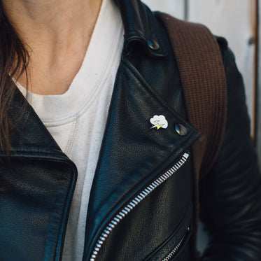 enamel pin on leather jacket