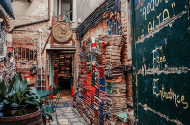 entrance to a bookstore with a wall lined with books