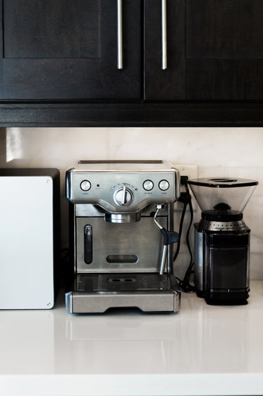 espresso maker on white stone counter