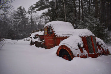 Falling Snow Covers Abandoned Vintage Truck