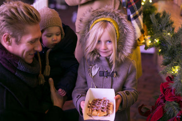 family at christmas market waffle win