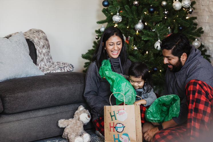 Family Unwrapping Holiday Gifts