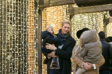 family with holiday lights