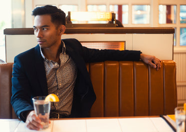 fashionable man sits in booth