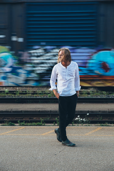 Browse Free HD Images of Fashionable Man Walks By Train Tracks