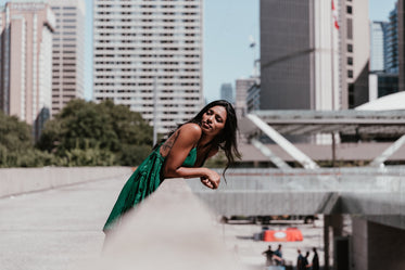 fashionable woman with city buildings behind