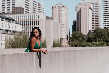 fashionable woman with high rises behind